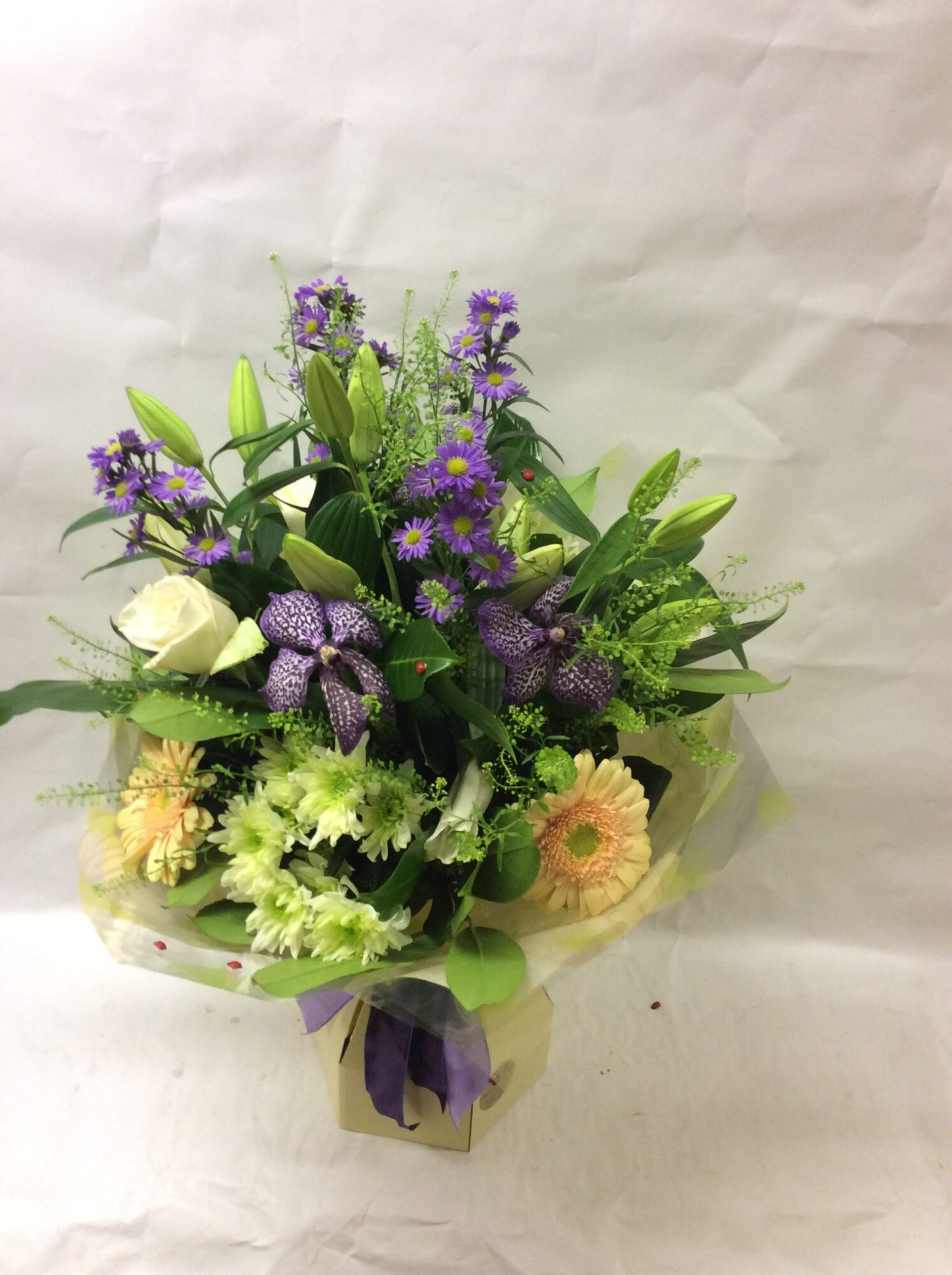 This gorgeous, bespoke handtied consists of lilies, vanda orchids, gerberas, chrysanthemum, roses and season permitting, September flower. This is suitable for any occasion, including birthdays, anniversaries, thank you, etc.